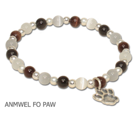 Animal Welfare bracelet by A Different Twist with black, white, brown and gray fiber optic beads with a sterling silver Paw charm and spacer beads on jeweler's elastic available in three sizes.