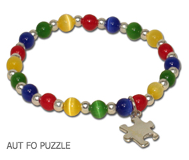 Autism Awareness bracelet by A Different Twist with blue, green, yellow and red fiber optic beads with a sterling silver Puzzle charm and spacer beads on jeweler's elastic available in three sizes.